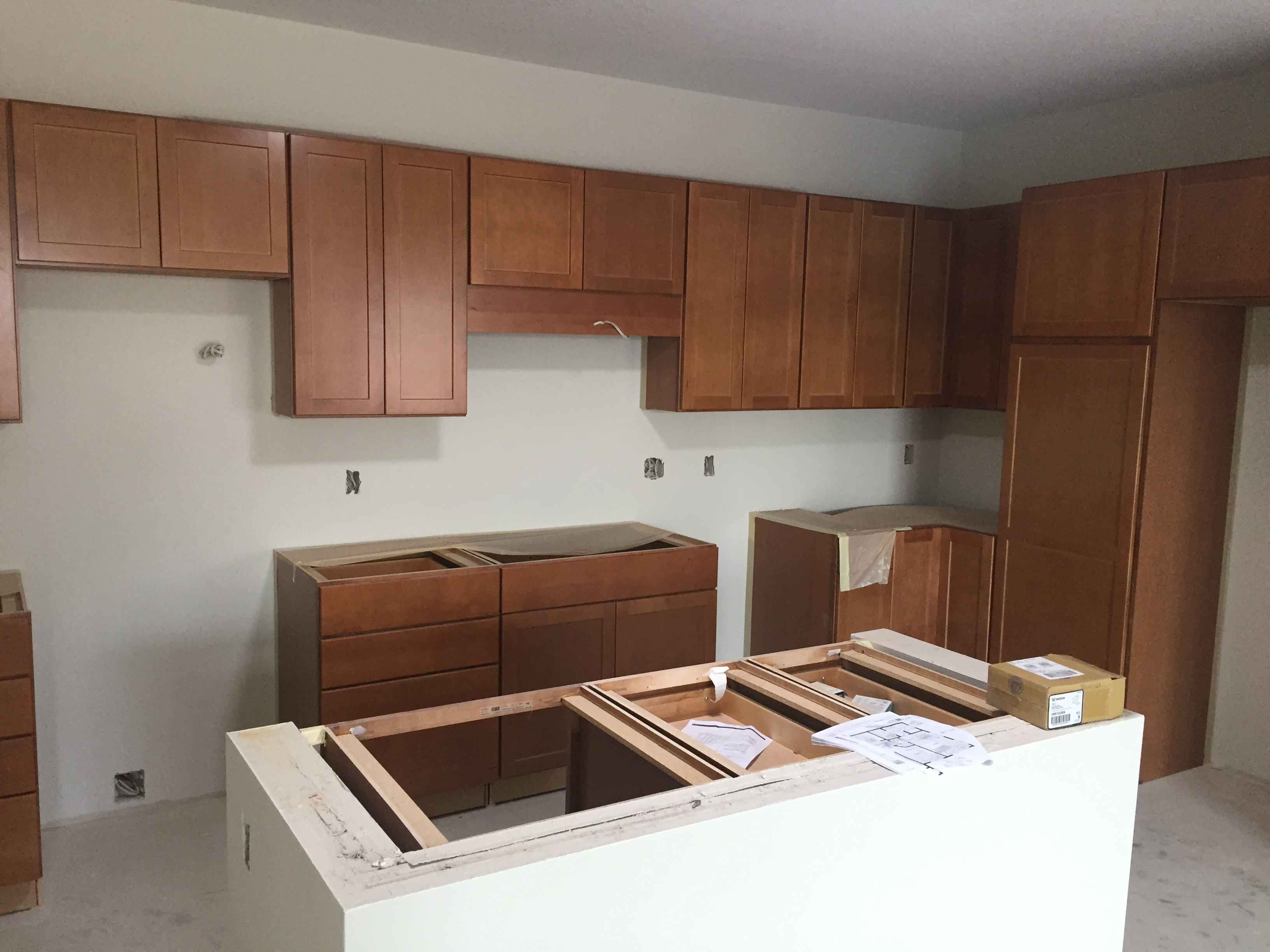 Unit with cabinets and island installed