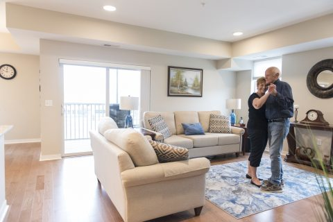 Members dancing in their home